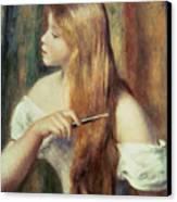Blonde Girl Combing Her Hair Canvas Print by Pierre Auguste Renoir