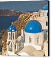 Blue Churches Of Santorini Canvas Print by Jim Chamberlain