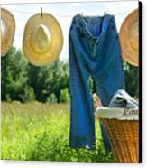 Blue Jeans And Straw Hats On Clothesline Canvas Print