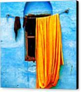 Blue Wall With Orange Sari Canvas Print by Derek Selander
