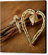 Braided Wicker Heart On Small Bundled Wood Canvas Print