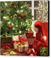 Brightly Lit Christmas Tree With Lots Of Gifts Canvas Print by Sandra Cunningham