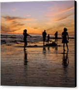 Children Playing On The Beach At Sunset Canvas Print
