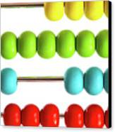 Closeup Of Bright  Abacus Beads On White Canvas Print by Sandra Cunningham