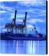 Container Cargo Freight Ship With Working Crane Bridge In Shipya Canvas Print by Anek Suwannaphoom