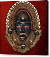 Dean Gle Mask By Dan People Of The Ivory Coast And Liberia On Red Velvet Canvas Print by Serge Averbukh