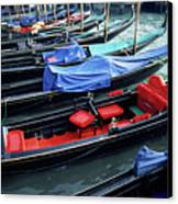 Empty Gondolas Floating On Narrow Canal Canvas Print by Sami Sarkis