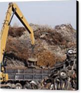 Excavator Moving Scrap Metal With Electro Magnet Canvas Print