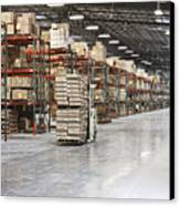 Forklift Moving Product In A Warehouse Canvas Print