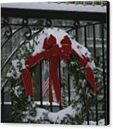 Fresh Snow Covers A Christmas Wreath Canvas Print by Stephen St. John