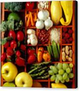 Fruits And Vegetables In Compartments Canvas Print by Garry Gay