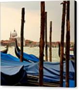 Gondolas And Poles In Venice Canvas Print