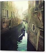 Gondolas In Venice Against Sun Canvas Print by Marco Misuri