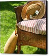 Grass Lawn With A Wicker Chair  Canvas Print