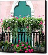 Green Ornate Door With Geraniums Canvas Print