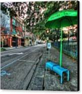 Green Umbrella Bus Stop Canvas Print by Michael Thomas