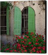 Green Windows And Red Geranium Flowers Canvas Print by Yair Karelic
