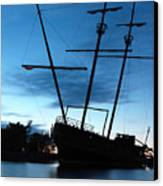 Grounded Tall Ship Silhouette Canvas Print by Oleksiy Maksymenko
