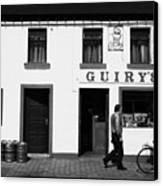 Guirys Irish Pub Foxford County Mayo Ireland Canvas Print by Joe Fox