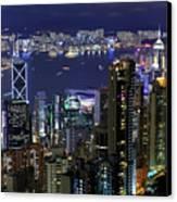 Hong Kong At Night Canvas Print by Leung Cho Pan