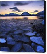 Ice Flakes Drifting Against The Sunset Canvas Print by Arild Heitmann