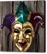 Jester Mask Hanging On Wooden Wall Canvas Print