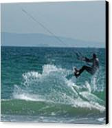 Kite Surfer Jumping Over A Wave Canvas Print by Sami Sarkis