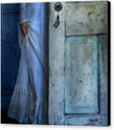 Lady In Vintage Clothing Hiding Behind Old Door Canvas Print by Jill Battaglia