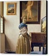 Lady Standing At The Virginal Canvas Print by Jan Vermeer