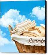 Laundry Basket  Against A Blue Sky Canvas Print by Sandra Cunningham
