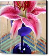 Lily On A Painted Table Canvas Print
