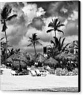 Lined Up At Punta Cana Canvas Print by John Rizzuto