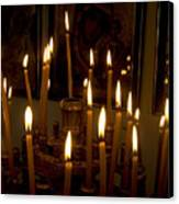 lit Candles in church  Canvas Print