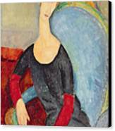Mme Hebuterne In A Blue Chair Canvas Print by Amedeo Modigliani