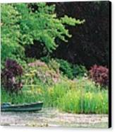 Monet's Garden Pond And Boat Canvas Print