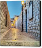 Old Stone Alleyway With Electric Lights Canvas Print by Noam Armonn