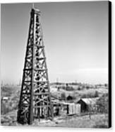 Old Wooden Derrick Canvas Print by Larry Keahey