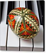 Painted Easter Egg On Piano Keys Canvas Print by Garry Gay
