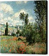 Path Through The Poppies Canvas Print by Claude Monet