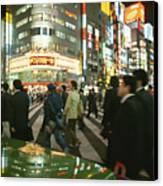 Pedestrians Cross A Crowded Tokyo Canvas Print by Justin Guariglia