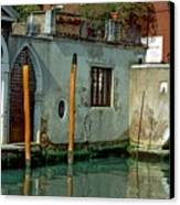 Poles On Canal In Venice Canvas Print
