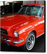 Red 1965 Ford Mustang . Front Angle Canvas Print by Wingsdomain Art and Photography