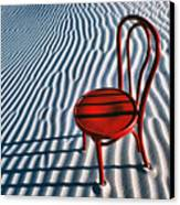 Red Chair In Sand Canvas Print