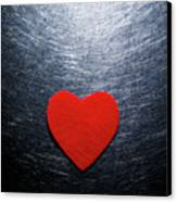 Red Felt Heart On Stainless Steel Background. Canvas Print by Ballyscanlon