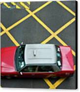 Red Taxi Cab Driving Over Yellow Lines In Hong Kong Canvas Print