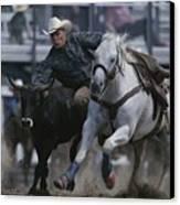 Ricky Huddleston Drops Off His Horse Canvas Print by Bobby Model