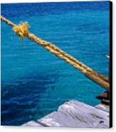 Rope On Mooring Post Canvas Print by Sami Sarkis