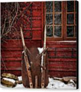 Rusty Wheelbarrow Leaning Against Barn In Winter Canvas Print by Sandra Cunningham