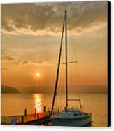 Sailboat And Sunrise Canvas Print by Steven Ainsworth