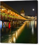 Scenic Night View Of The Chapel Bridge In Old Town Lucerne Canvas Print by George Oze